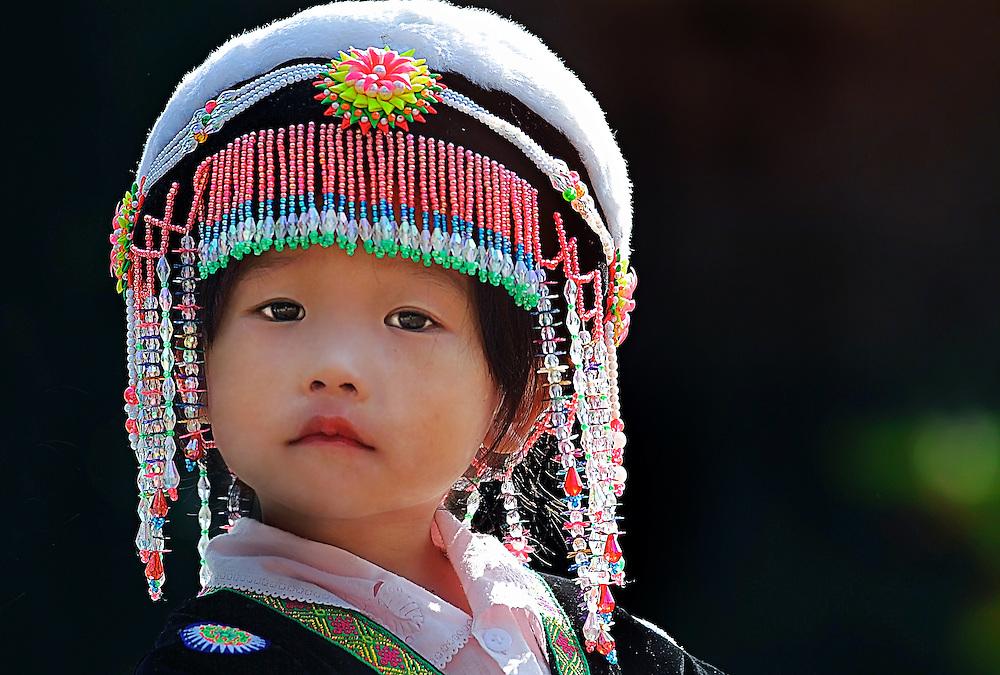 A young Hong girl during the Hmong new year celebrations in Luang Prabang, Laos.
