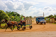 Horse and cart lead a Russian truck in Yaguaramas, Cienfuegos Province, Cuba.