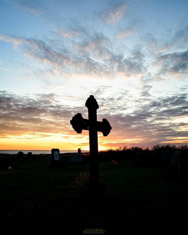 Sunset at  Varhaug gamle kirkegård, Norway.