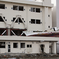 A boats sits lodged on the Minami-Sanriku Hospital building, washed there by the 2011 tsunami, on the 1 year anniversary of the March 11th 2011 earthquake and tsunami, in Minami-Sanriku, Tohoku region, Japan on Sunday 11th March 2012.