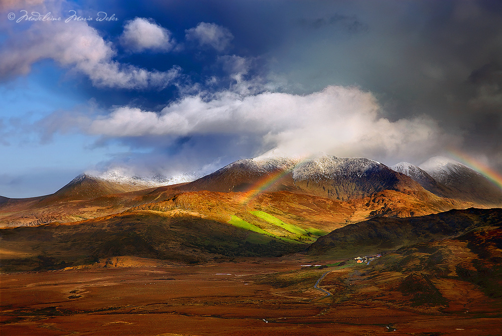 Stormy irish weather and Rainbow over snow covered highest peak carrantuohill, Macgillycuddys Reeks, County Kerry, Ireland / ba040