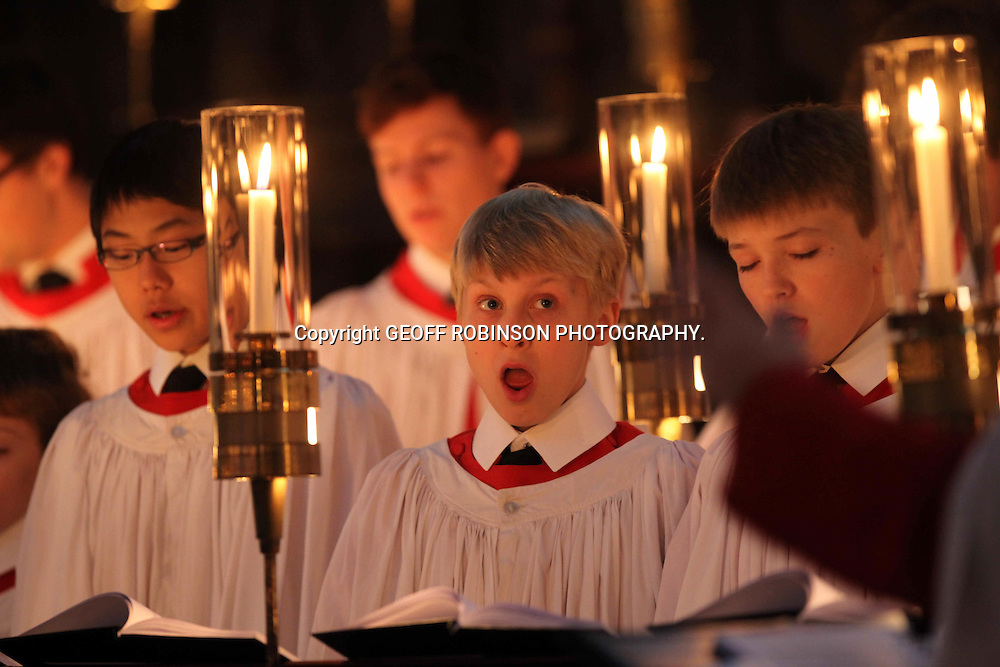 "KING'S COLLEGE  CHOIR BOYS PREPARING FOR THIS YEARS CHRISTMAS EVE SERVICE AT KINGS COLLEGE CHAPEL IN CAMBRIDGE... After months of rehearsing 16 elite choristers will perform in front of millions at the world-famous carol service at King's College chapel today (Sat Dec 24)..The boys have spent hours practicing for the 90-minute candle-lit Festival of Nine lessons and Carols, which is broadcast live on BBC Radio 4...An incredible 40 million people across the globe tune into the service, which is also televised on BBC2 and tells the Christmas story through poetry and bible readings...Hundreds have been queuing since 7am this morning (Sat) to watch the carol concert in the historic gothic Chapel, which will end as always with Hark the Herald Angels Sing...The boys will line up in King's College Chapel in front of the choral scholars, made up of altos, tenors and basses, who are all undergraduates, shortly before 3pm...It promises to be the performance of his life for one young chorister who will start service with a solo of Once in Royal David's City as has been the tradition since 1919...But he will not be chosen until the last moment to prevent unnecessary nerves...""The service has become a traditional part of Christmas for many people,"" said Stephen Cleobury, director of music at King's College in Cambridge, who has conducted the carols for the last 30 years...SEE COPY CATCHLINE King's xmas eve carol service"