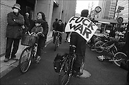 A cyclist shows his thoughts on the war in Iraq on a day of anti-American and anti-Iraq war protest in Tokyo, Japan