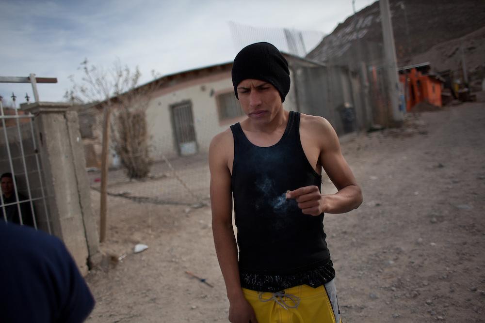 """""""El Mongo"""" smokes marijuana outside his home in Ciudad Juarez, Mexico."""