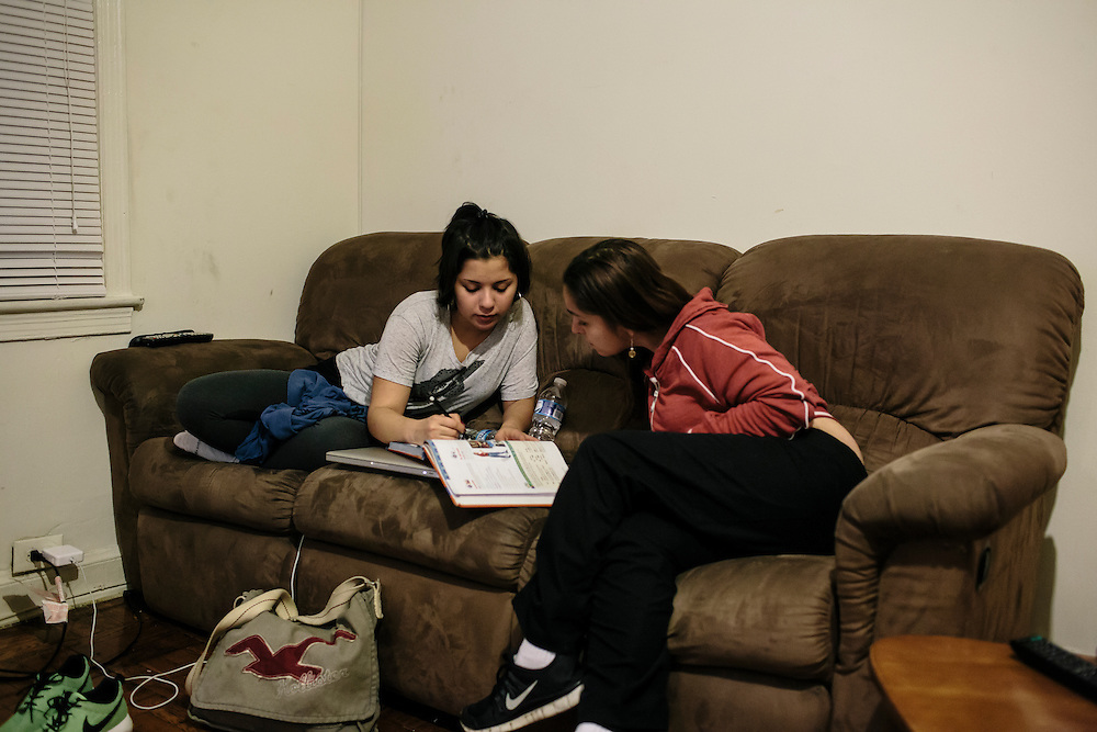 Daniela Shia-Sevilla, 15, gets help from her mom, Chi Shia, with her Spanish homework at their apartment in Fort Totten. Shia-Sevilla is an only child and spends her evenings doing homework often past midnight.