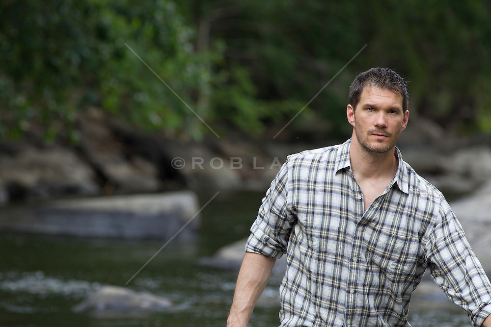 good looking man at a stream in Upstate New York