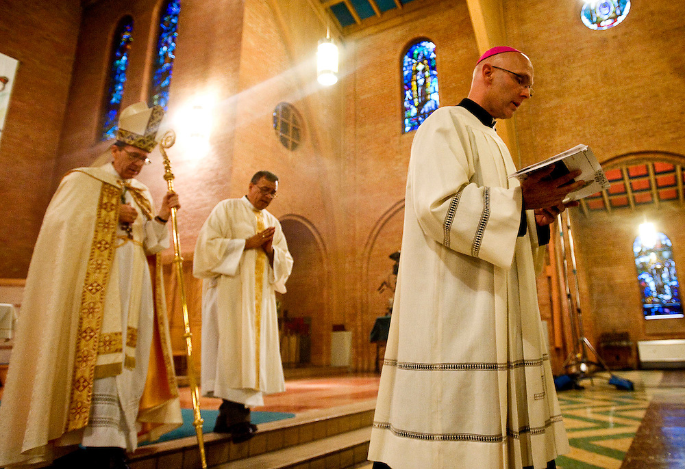042209     Brian Leddy.Bishop-elect James S. Wall leaves the sanctuary at Sacred Heart Cathedral on Wednesday evening after a Vespers Mass. Wall will be ordained as the new bishop of the Gallup Catholic Diocese today.