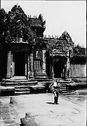 Entrance to Banteay Srey. The temple was constructed under the powerful king Rajendravarman and later under Jayavarman V. The deep and intricate carvings of Banteay Srey are some of the finest examples of classical Khmer art.