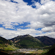 SHOT 7/16/11 1:53:27 PM - A view of the valley and town of Silverton, Co. from above. The San Juan Mountains are a high and rugged mountain range in the Rocky Mountains in southwestern Colorado. The area is highly mineralized (the Colorado Mineral Belt) and figured in the gold and silver mining industry of early Colorado. The San Juan and Uncompahgre National Forests cover a large portion of the San Juan Mountains. The town of Silverton is a Statutory Town that is the county seat of, and the only incorporated municipality in, San Juan County, Colorado, United States.[8] Silverton is a former silver mining camp, most or all of which is now included in a federally designated National Historic Landmark District, the Silverton Historic District. The town population was 531 at U.S. Census 2000. (Photo by Marc Piscotty / © 2011)
