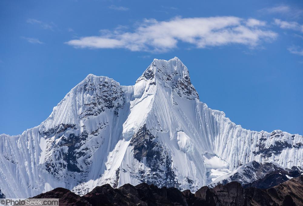 Nevado Jirishanca (Icy Beak of the Hummingbird, 6126 m or 20,098 feet). Day 8 of 9 days trekking around the Cordillera Huayhuash in the Andes Mountains, LLamac, Peru, South America.
