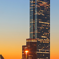 Boston sunset photography on tap showing The Clarendon and 200 Clarendon better known as the John Hancock Tower. The long exposure photography sunset photo was captured on a stunning night when the last light painted the skyscrapers and sky in beautiful orange and blue hues.<br />