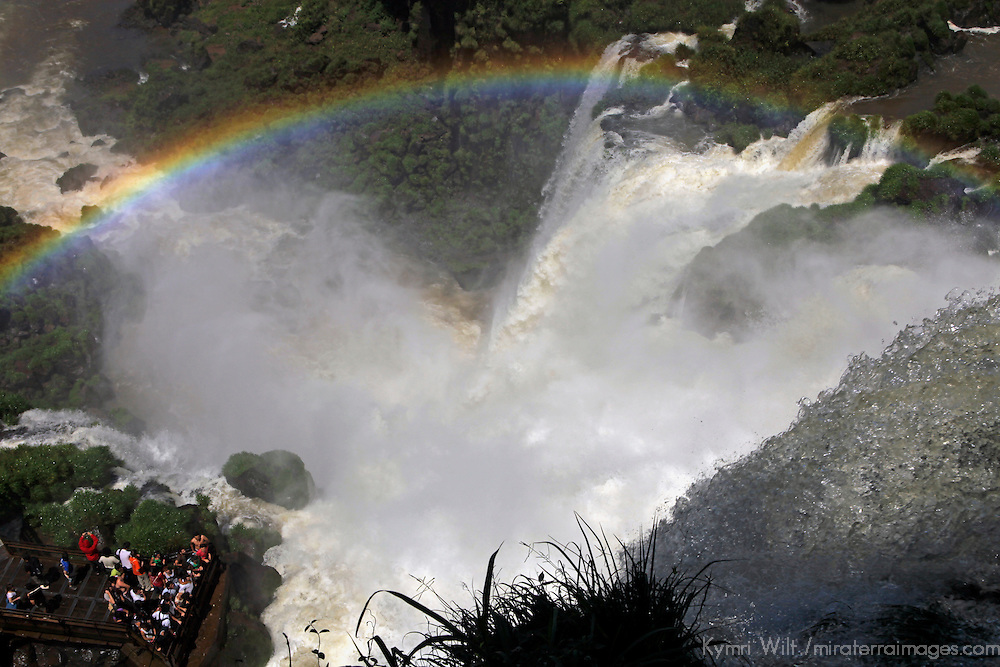 South America, Argentina, Iguacu Falls. Rainbow over visitors at Iguacu Falls.