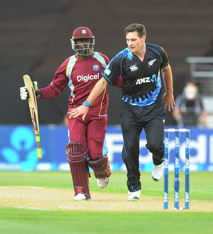New Zealand's Mitchell McClenaghan, right, runs in front of West Indies Andre Fletcher in the second T20 International cricket match, Westpac Stadium, Wellington, New Zealand, Wednesday, January 15, 2014. Credit:SNPA / Ross Setford