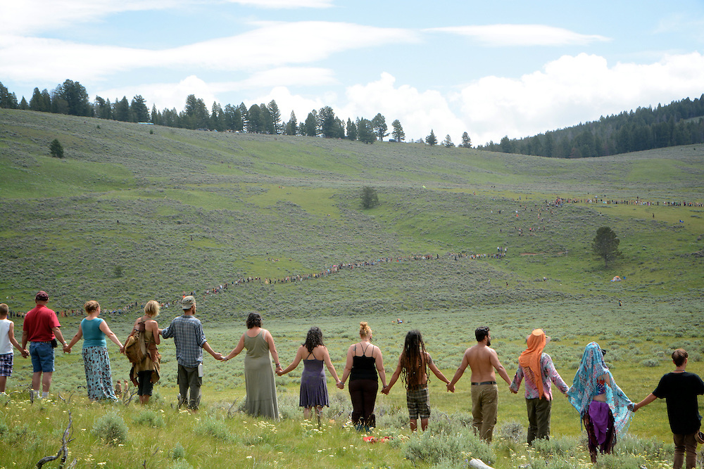 Om circle 4th of July.  Main Circle.  Rainbow Gatherings started back in 1972, acts of self-expression, inclusiveness, and the right to peacefully assemble. Rainbow Gathering 2013 was held in Montana, outside of Jackson.