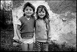 Roma kids with cigarette, Valcau, Transylvania, Romania. August 1996