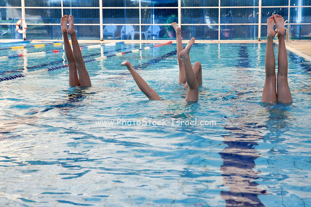 people doing aqua aerobics in a pool