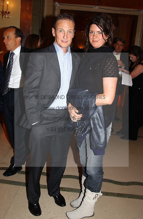 RICHARD DUNWOODY and DAWN PORTER at the 2005 Clicquot Award - Business Woman of The Year award ceremony held at Claridge's, Brook Street, London W1 on 28th April 2005.