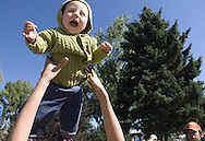 Seven-month-old Dagan Restuccia enjoys some air time as he's tossed by his mother, Dale Sharkey of Victor, during the farmer's market at the Town Square in Jackson, Wyoming.