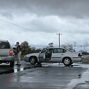 10/30/12 - Smyrna, DE - Hurricane Sandy - A Delaware State Trooper cautions motorist at the intersection of Route 9 and Woodland beach Rd Tuesday, Oct. 30, 2012, in Smyrna DE.  ..SAQUAN STIMPSON/Special to The News Journal