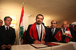 Less than two weeks before Lebanese go to the polls to elect a new parliament, leaders of the various parties that make up the governing March 14 coalition met in Beirut's Bristol Hotel to reaffirm their partnership. The meeting was attended by dozens of political leaders including Sunni Muslim leader of the Future Movement, Saad Hariri, and Druze leader, Walid Jumblatt. The upcoming parliamentary elections are important in that they put the pro-Western March 14 alliance against the Hizballah-led March 8 alliance. Saad Hariri said earlier in the day, that he refuses to join any coalition with the resistance and political group, who is supported by Iran and Syria. ///Saad Hariri, Sunni leader and head of the Future Movement signs the March 14 unity statement at the end of the coalition's meeting.