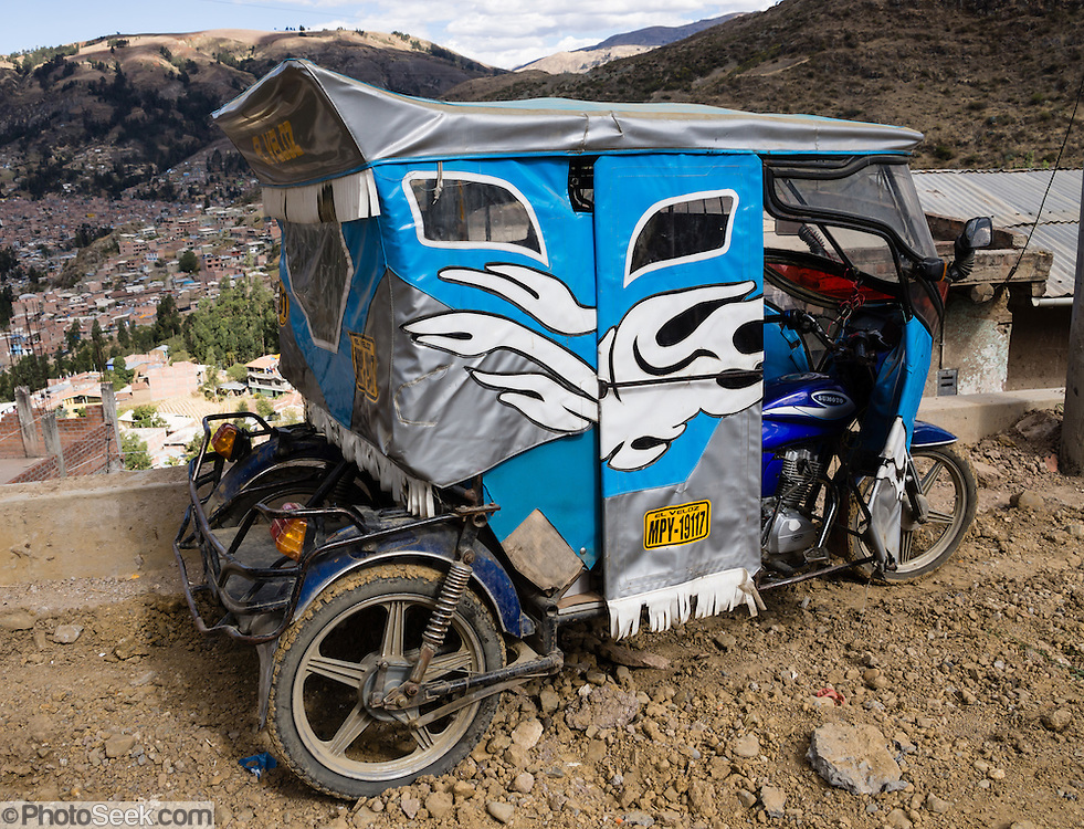A mototaxi (three-wheeled auto rickshaw) provides cheap public transportation in Huaraz, in the Andes Mountains, Ancash Region, Peru, South America.