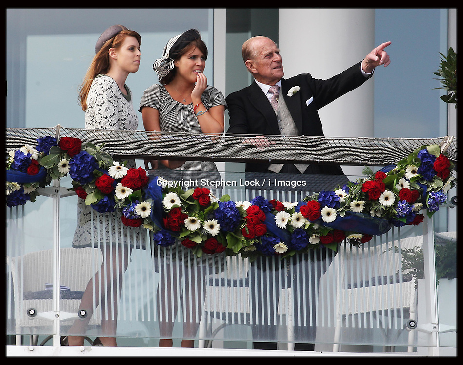 Princess's Eugenie and Beatrice with Duke of Edinburgh at  the Epsom Derby, Saturday, 2nd June 2012.  Photo by: Stephen Lock / i-Images