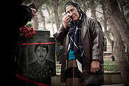 Mother cries on the grave of her son-Azeri soldier who died during the war in Nagorno-Karabakh...The Nagorno-Karabakh War was an armed conflict that took place from February 1988 to May 1994, in the small enclave of Nagorno-Karabakh in southwestern Azerbaijan, between the majority ethnic Armenians of Nagorno-Karabakh backed by the Republic of Armenia, and the Republic of Azerbaijan. Gradually it grew into an increasingly violent conflict between ethnic Armenians and ethnic Azerbaijanis, resulting in claims of ethnic cleansing by all sides.As many as 230,000 Armenians from Azerbaijan and 800,000 Azeris from Armenia and Karabakh have been displaced as a result of the conflict..