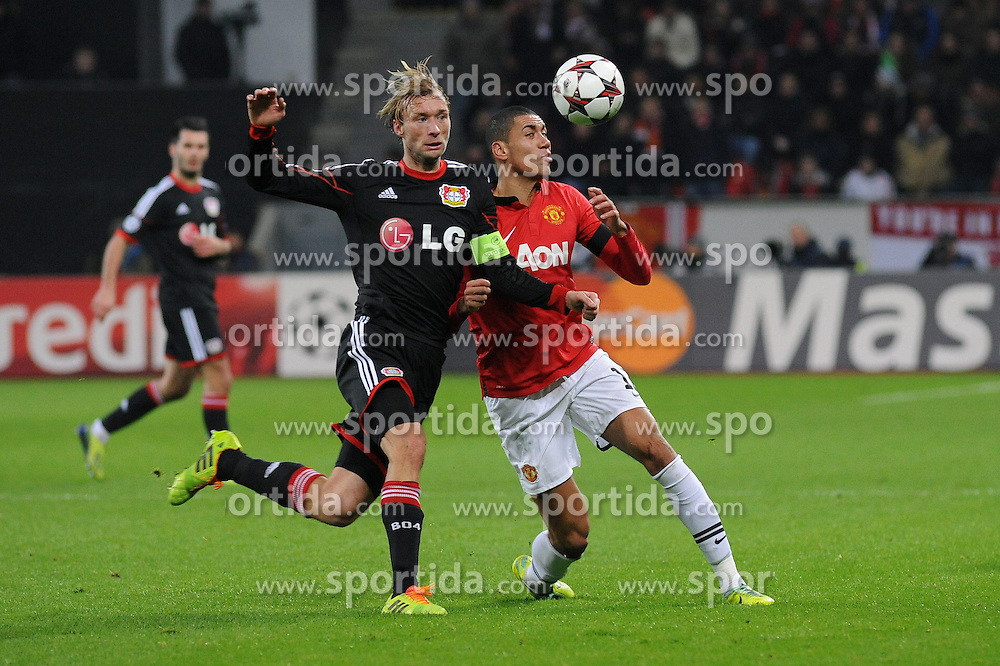 27.11.2013, BayArena, Leverkusen, GER, UEFA CL, Bayer Leverkusen vs Manchester United, Gruppe A, im Bild Simon Rolfes ( links Bayer 04 Leverkusen ) im Zweikampf mit Chris Smalling ( rechts Manchester United / Action / Aktion ) // during UEFA Champions League group A match between Bayer Leverkusen vs Manchester United at the BayArena in Leverkusen, Germany on 2013/11/28. EXPA Pictures &copy; 2013, PhotoCredit: EXPA/ Eibner-Pressefoto/ Thienel<br /> <br /> *****ATTENTION - OUT of GER*****