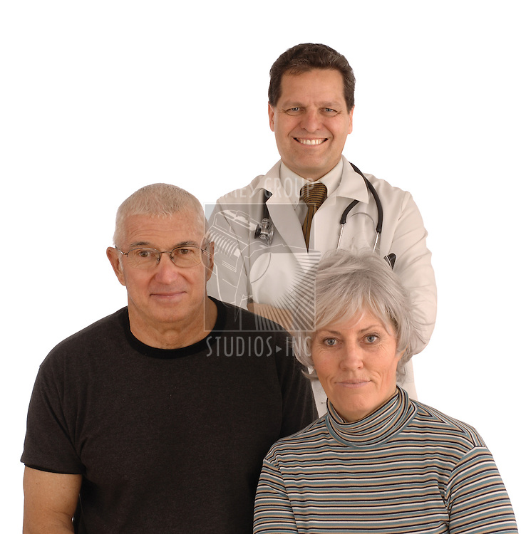 Senior couple and doctor facing camera on a white background