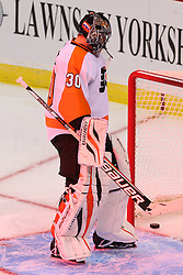 Jan 22, 2013; Newark, NJ, USA; Philadelphia Flyers goalie Ilya Bryzgalov (30) looks at the puck after giving up a penalty shot goal to New Jersey Devils left wing Ilya Kovalchuk (17) during the second period at the Prudential Center.