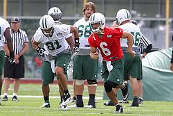 June 14, 2012; Florham Park, NJ, USA; New York Jets tight end Dustin Keller (81) and New York Jets quarterback Mark Sanchez (6) run sprints during New York Jets Minicamp at the Atlantic Health Training Center.