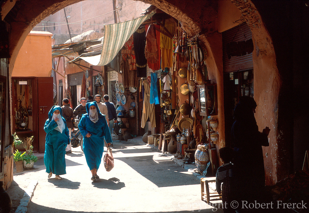 MOROCCO, MARRAKECH Medina; crowded narrow lanes lined with shops selling all kinds of merchandise