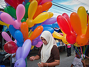 """Sept 29, 2009 - YARANG, THAILAND: A Muslim woman walks among balloons for sales at a street fair in Yarang, Thailand, Sept. 29. Thailand's three southern most provinces; Yala, Pattani and Narathiwat are often called """"restive"""" and a decades long Muslim insurgency has gained traction recently. Nearly 4,000 people have been killed since 2004. The three southern provinces are under emergency control and there are more than 60,000 Thai military, police and paramilitary militia forces trying to keep the peace battling insurgents who favor car bombs and assassination.   Photo by Jack Kurtz / ZUMA  Press"""