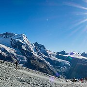 Left to right are the peaks of: Castor, Pollux, Breithorn, and Matterhorn, in the Pennine/Valais Alps, Europe. In Zermatt, the Gornergrat rack railway (GGB) takes you to a spectacular ridge (at 3135 m or 10,285 ft) between Gornergletscher and Findelgletscher, with views of more than twenty 4000-meter-high peaks. Gornergrat train, opened in 1898, climbs almost 1500 m or 4900 ft via Riffelalp and Riffelberg. This image was stitched from multiple overlapping photos.