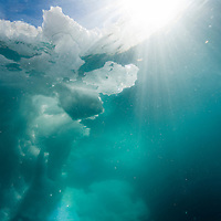 Greenland, Ilulissat, Underwater view of iceberg along western coastline on summer morning