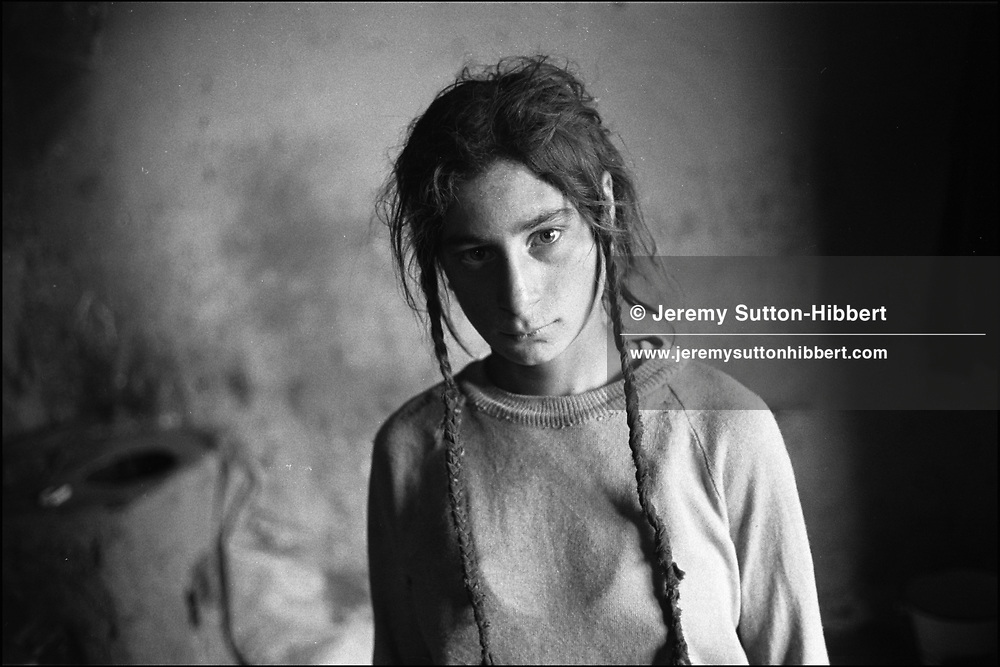 NICOLETTA GARAFA MIHAI, THE DAY AFTER THE FUNERAL OF HER 4 YEAR OLD BROTHER FLORIN. SINTESTI, ROMANIA. MAY 1997..©JEREMY SUTTON-HIBBERT 2000..TEL./FAX.+44-141-649-2912..TEL.  +44-7831-138817.