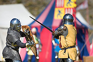 McG0064278<br /> Performers in heavy armour fight at Portchester Castle in Hampshire where events have been taking place to mark the 600th anniversary of the battle of Agincourt. <br /> In 1415 soldiers left from the castle, now managed by English Heritage, for northern France where they went on to face the French in a muddy farmer's field.<br /> Picture date: Saturday August 8, 2015.<br /> Photograph by Christopher Ison &copy;<br /> 07544044177<br /> chris@christopherison.com<br /> www.christopherison.com