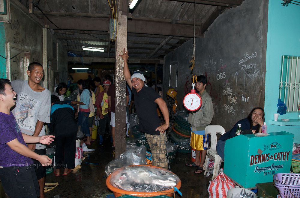 "As usual, there was an abundance of hardworking Filipinos willing to take 5 seconds to pose for the camera at 3 AM at the Fisherman's Wharf in Paranaque City, where the fresh catch is negotiated for sale based on ""whispered"" prices."