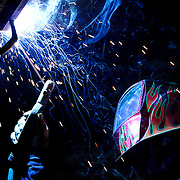 Kevin C. Davis of Iron Man Inc welding metal to the ceiling Tuesday, Sept. 16, 2014 at The Artist Warehouse in Chester PA