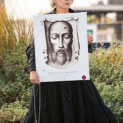 "Lisa Johnston  |  lisajohnston@archstl.org  |  @aeternusphoto  Holding an image of the Holy Face, Colleen George stood in the median strip outside of Planned Parenthood on a second national day of protest. Devotion to the Holy Face of Jesus includes asking for forgiveness from our Lord against the blasphemies of the world and atoning for sin. ""You can not be more blasphemous than killing innocent children,"" said George. The protest took place simultaneously at hundreds of Planned Parenthood locations across the nation. #‎ProtestPP is a coalition of state and national pro-life organizations seeking a public protest in response to the recent horrific videos exposing Planned Parenthood harvesting baby body parts for a financial gain. The videos released by Center for Medical Progress has changed the conversation about abortion in the nation."
