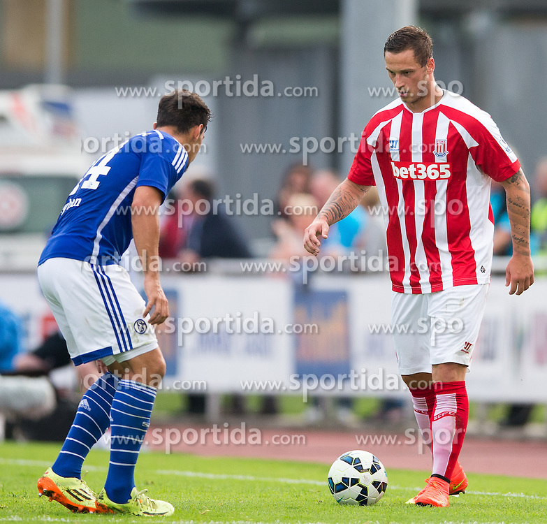 29.07.2014, Kufstein Arena, Kufstein, AUT, FS Vorbereitung, Testspiel, FC Schalke 04 vs Stoke City, im Bild Kaan Ayhan (FC Schalke 04) gegen Marko Arnautovic (Stoke City) // during a Friendly Match between FC Schalke 04 and Stoke City at the Kufstein Arena, Kufstein, Austria on 2014/07/29. EXPA Pictures © 2014, PhotoCredit: EXPA/ Johann Groder