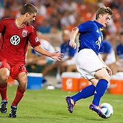 Everton Attacker Conor McAleny #11(right) and DC Defender Perry Kitchen (left) fight for procession of the ball during the MLS International friendly match between Everton FC of England and DC United. ..Everton FC Defeated DC United 3-1 Saturday, July 23, 2011, at  RFK Stadium in Washington DC.