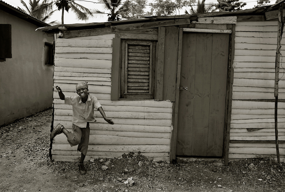 Batey AB-4, Dominican Republic-  A child plays outside a home in Batey AB-4. A recent ruling by the Constitutional Court of the Dominican Republic has terminated citizenship rights to anyone born after 1929 to parents who are not of Dominican ancestry. These Dominican citizens are suddenly stateless and without rights simply because of their Haitian ancestry. (Photo by Robert Falcetti)
