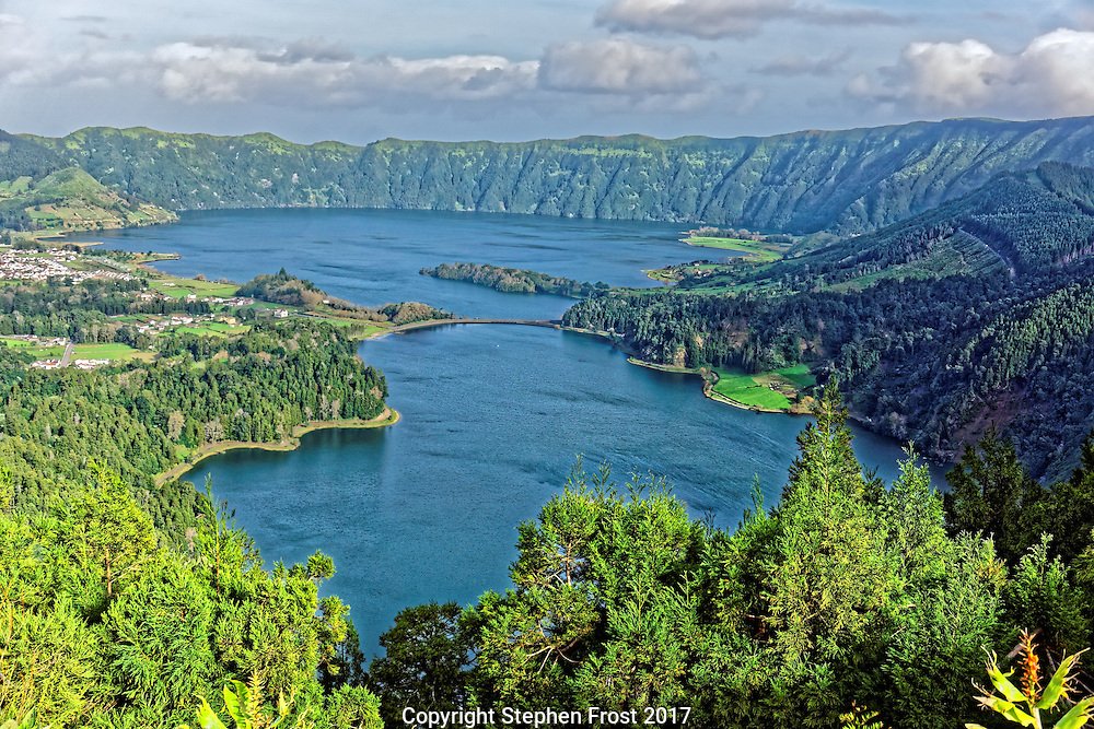 Twin lakes in the crater of a dormant volcano, on the Island of São Miguel in the Portuguese archipelago of the Azores. The area is known locally as Lagoa das Sete Cidades.
