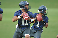 Mississippi quarterbacks Barry Brunetti (11) and Randall Mackey (1) run a drill as the Rebels began football practice in Oxford, Miss. on Saturday, August 6, 2011. The team began practicing outside before lightning in the area sent them indoors for practice. (AP Photo/Oxford Eagle, Bruce Newman)