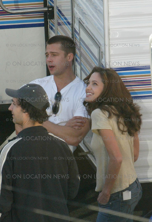 January 22, 2004, Los Angeles, CA <br /> Brad Pitt &amp; Angelina Jolie are photographed together for the first time ever after arriving on set of Mr &amp; Mrs Smith where they are seen reviewing the filming script and wardrobe outside their trailers. <br /> They fell in love during the filming of this movie and Brad Pitt was still married to Jennifer Aniston at the time. Photos by Eric Ford Tel 818-613-3955 OLNpix@gmail.com