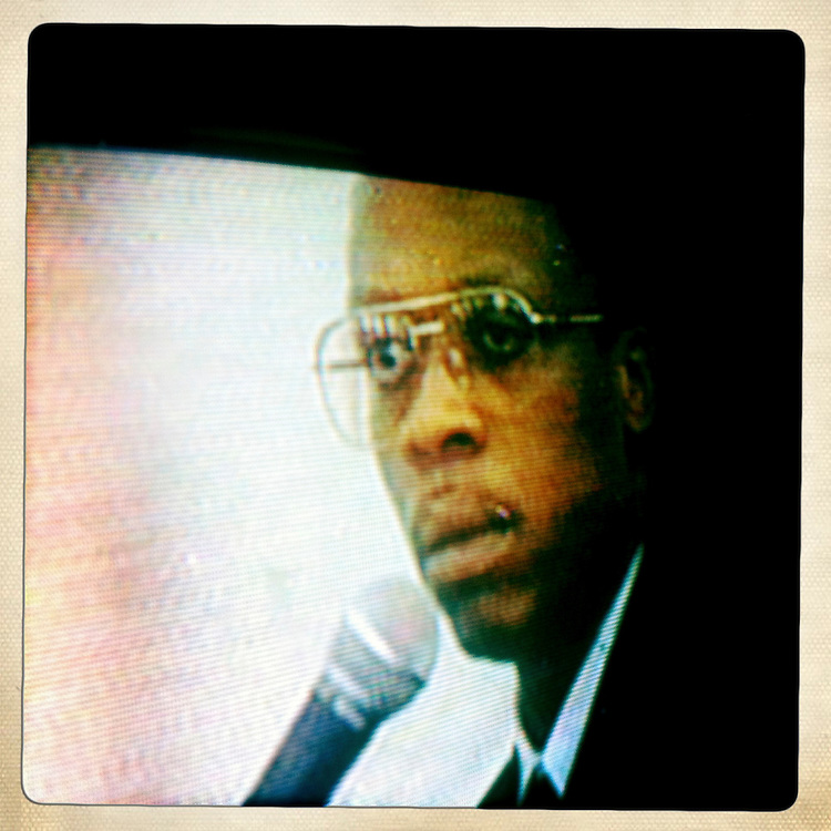 Aristide is seen on a television on Tuesday, April 3, 2012 in Kenscoff, Haiti.