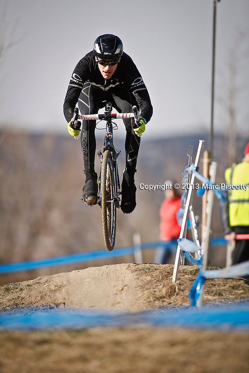 SHOT 1/12/14 2:03:50 PM - A competitor warms up for the Men's Elite race at the 2014 USA Cycling Cyclo-Cross National Championships at Valmont Bike Park in Boulder, Co.  (Photo by Marc Piscotty / © 2014)