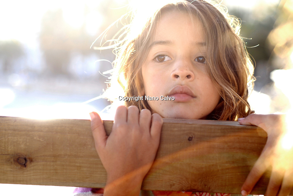MR Portrait of Morgana, a cute seven year old brazilian girl, playing on the beach of Santa Eulalia del Rio, Ibiza, Spain, during a beautiful and sunny day