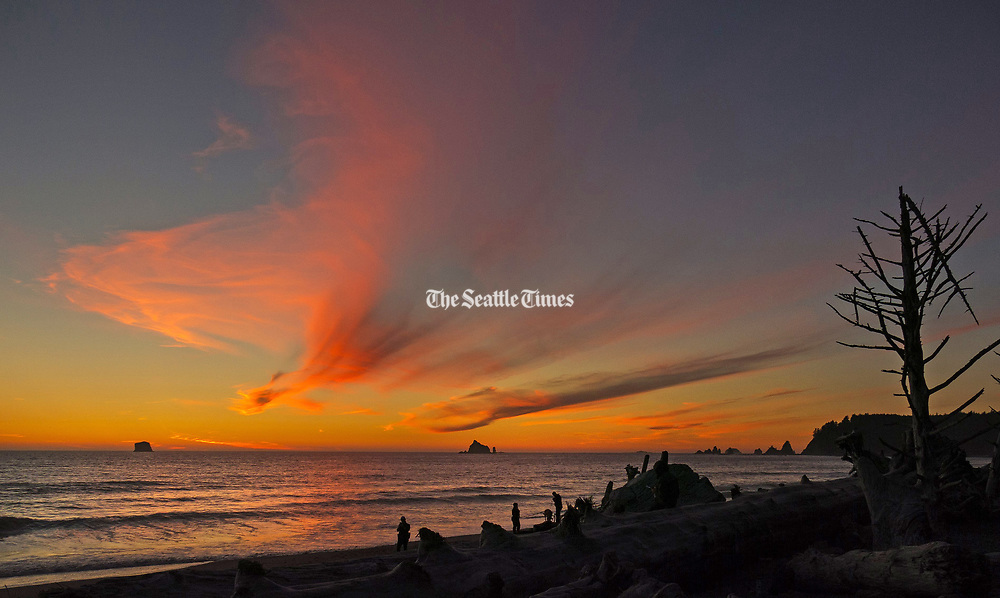Sunsets are spectacular at Rialto Beach in the Olympic National Park, about a 90-minute drive from Port Angeles. (Mike Siegel/The Seattle Times)